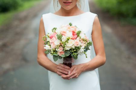 life partners: Beautiful wedding bouquet in hands of the bride.
