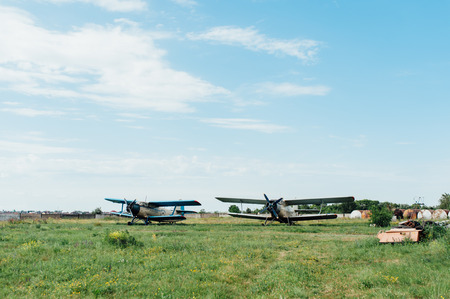 biege: Airplanes standing on green grass. Two old biplane in a retro style. biege aircraft. Ukraine, 2016