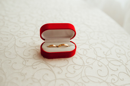 bedspread: wedding rings in the red box on the bedspread