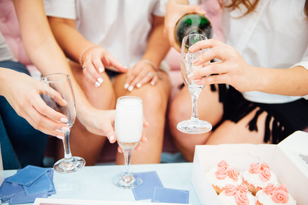 clink: Guests at a wedding with the bride and groom clink glasses of champagne or white wine