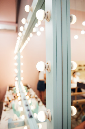 Woman's makeup place with mirror in beaty salon