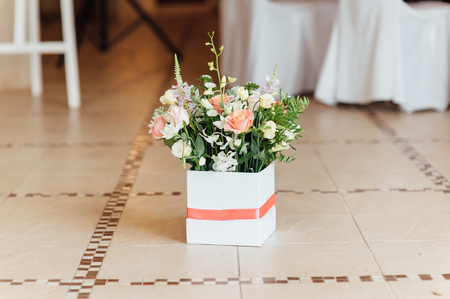 wooing: Beautiful bouquet of bright flowers in basket for wedding ceremony