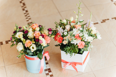 Two Beautiful bouquet of bright flowers in basket for wedding ceremony Stock Photo