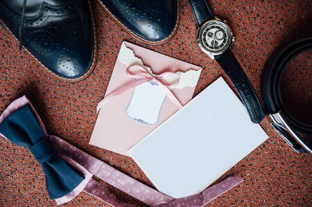 suede belt: Set of groom clothes. Wedding rings, shoes, cufflinks and bow tie detalis fashion. place for your text Stock Photo