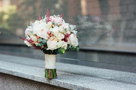 beautiful modern wedding bouquet on a stone slab. Stock Photo