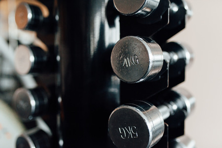 dumbbells in a fitness hall with daylight Stock Photo