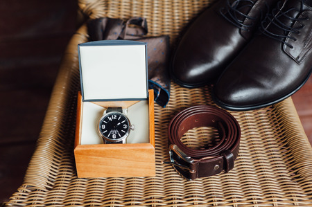Set of groom clothes. Wedding shoes, belt, watch and bow tie detalis fashion. The whole set of men executed in brown color. Luxury suite for real men