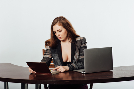 Sexy business woman or secretary with notebook Stock Photo