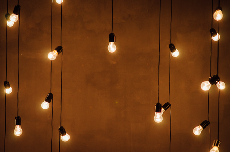 garland of edison lamps on a wooden background