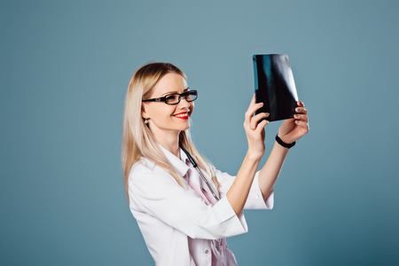 beautiful female doctor holding a scan Stock Photo
