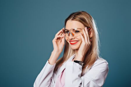 beautiful girl doctor holding glasses in hands