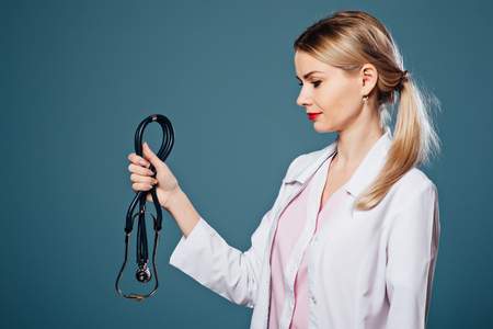 female doctors hand holds a stethoscope Stock Photo