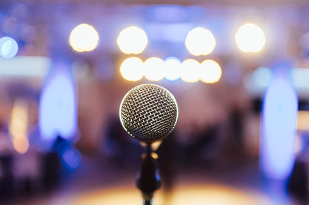 Microphone on blurred of speech in seminar room Stock Photo