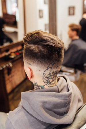 male model shows a haircut in a barber shop