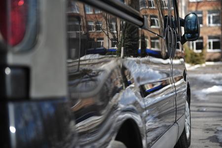 Polished side of black cargo minivan Standard-Bild