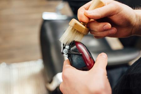 barber prepares to work trimmer