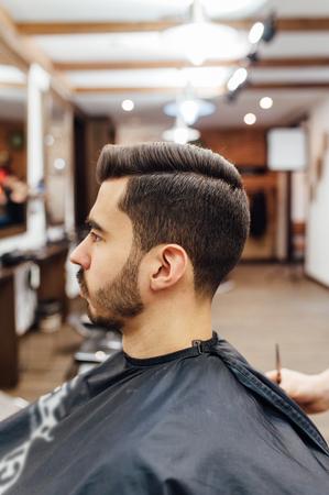Male model shows a haircut in a barber shop Standard-Bild