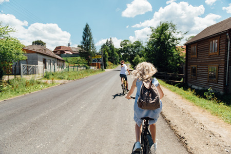 young couple in love ride on bicycles in the mountains