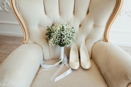 bridal bouquet of peones with white shoes Фото со стока