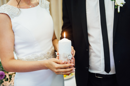 Candle in the hands of the newlyweds symbolizes hearth and well-being of the family. Stock fotó