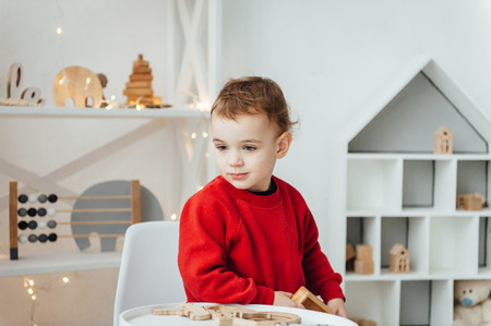 beautiful baby boy playing with toys and smiling Standard-Bild - 116292775