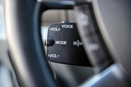 controls near the steering wheel in a modern car Standard-Bild - 116293649