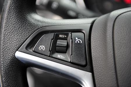 controls near the steering wheel in a modern car Standard-Bild - 116293656