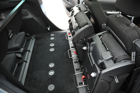 New car inside. Clean car interior. Black back seats transformer in sedan. Car cleaning theme. Standard-Bild - 116293659