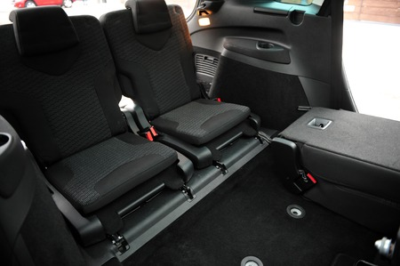New car inside. Clean car interior. Black back seats transformer in sedan. Car cleaning theme. Standard-Bild - 116293804