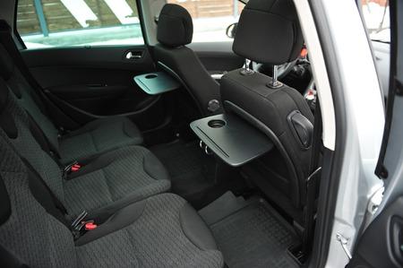 New car inside. Clean car interior. Black back seats transformer in sedan. Car cleaning theme.