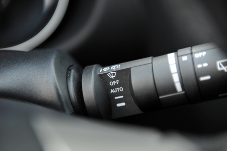 controls near the steering wheel in a modern car Standard-Bild - 116293981