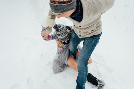 Happy Young Couple in Winter Park having fun.Family Outdoors. love Stock Photo
