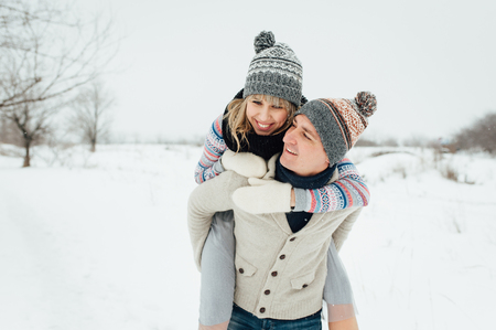 Happy Young Couple in Winter Park having fun.Family Outdoors. love Standard-Bild - 116294061
