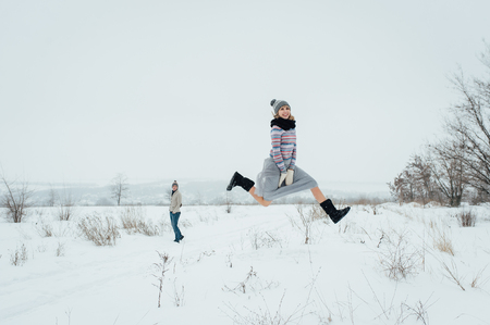 Happy Young Couple in Winter Park having fun.Family Outdoors. love Standard-Bild - 116294053