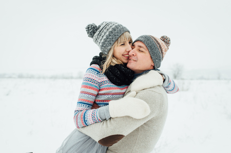 Happy Young Couple in Winter Park having fun.Family Outdoors. love Standard-Bild - 116294064
