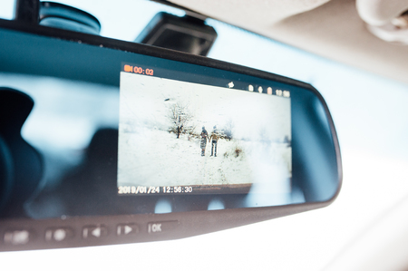 couple running in the snow. view through the screen of the DVR Standard-Bild - 116294065