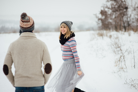 Happy Young Couple in Winter Park having fun.Family Outdoors. love Standard-Bild - 116294067