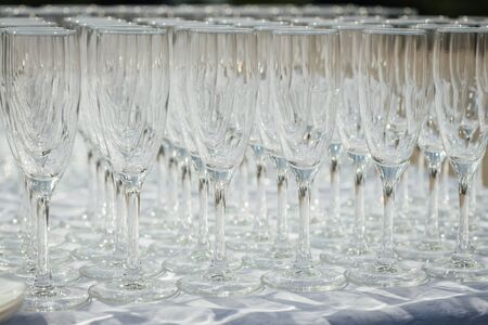 A row of empty champagne glasses on table. Banquet setting Stock Photo