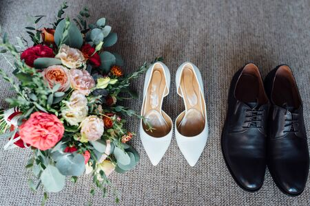 Wedding floristics and details. Wedding invitations on floor.