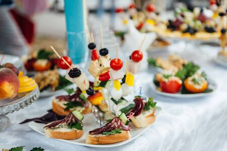 catering services background with snacks on guests table in restaurant at event party