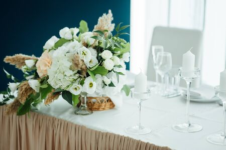 Luxurious wedding presidium in white with silver elements.