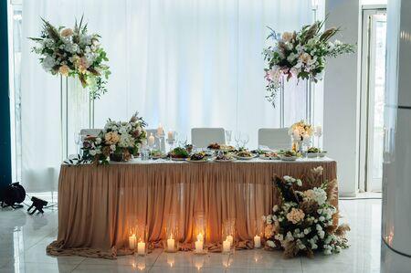 Luxurious wedding presidium in white with silver elements.