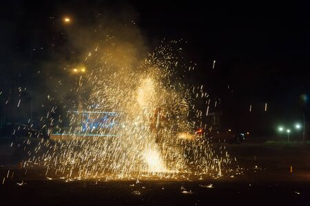 The bright spin fire sparks and fire show in the night 스톡 콘텐츠