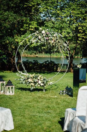 Arch for the wedding ceremony, decorated with cloth and flowers.