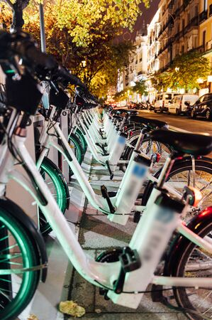 A charging station for rental electric bicycles for general use. Central street in Madrid. bikes can be rented using a smartphone.