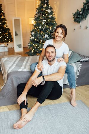 Romantic couple in love feeling happiness about their romance spending christmas eve together,