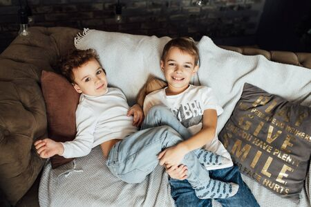 Two funny boys play together. Cute happy brothers smiling and having fun
