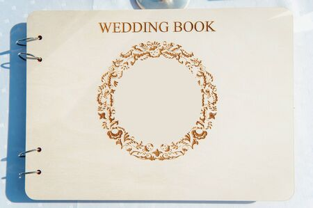 Wedding album, blank page, guest list, to do list. Notebook and asters on canvas background.