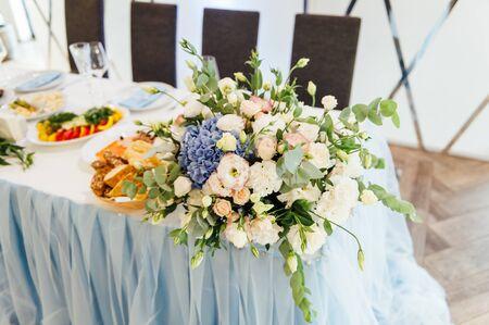 Luxurious wedding presidium in white with blue elements.