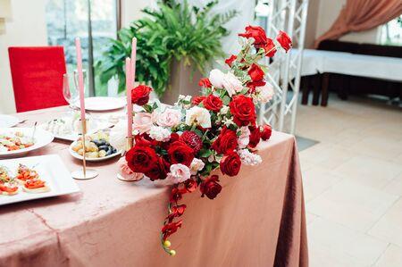 Luxurious wedding presidium in white with red elements.